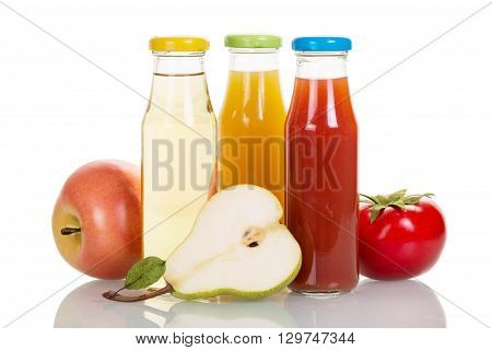 Bottles of fruit and vegetable juices isolated on white background.