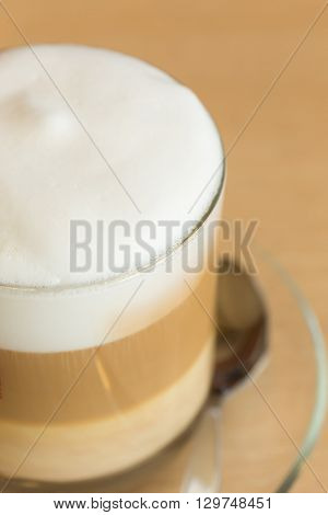Coffee Latte With Milk Froth In Cafe