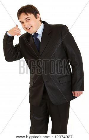 Smiling young businessman showing contact me gesture isolated on white