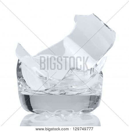 Shards of broken glass jar isolated on white background.