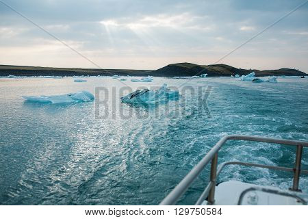 Sailing between icebergs in Jokulsarlon Lagoon, Iceland. Amphibian tour among melting glaciers.