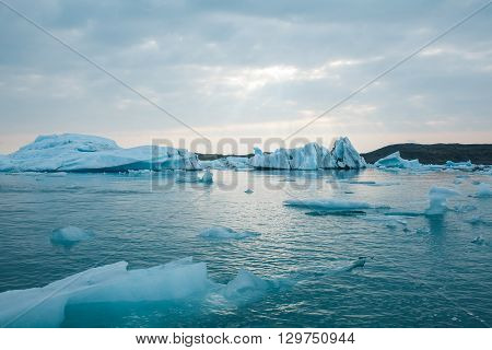 Sunset among icebergs. Sunset at Jokulsarlon Lagoon with melting glaciers.