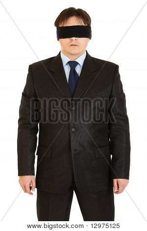Disoriented businessman with blindfold on eyes isolated on white