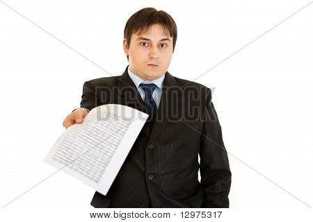 Surprised modern businessman giving document isolated on white