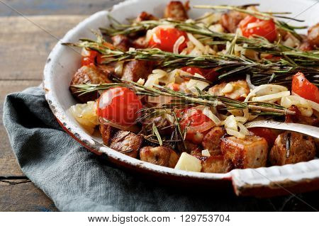 Roasted Beef Meat With Rosemary, Tomato And Onion On Frying Pan
