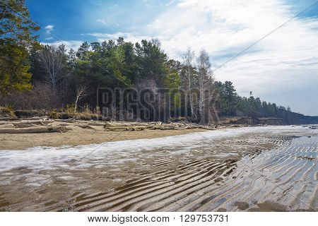 Spring melting of ice on the river. Russia Siberia Novosibirsk region Ob river