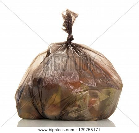 Garbage bags with food waste isolated on white background.