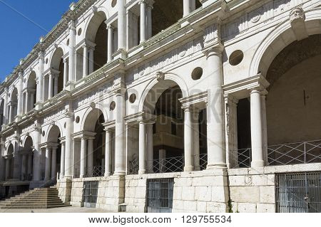 VICENZA,ITALY-APRIL 3,2015:view of the famous colonnade of the Palladian basilica in the center of Vicenza during a sunny day.