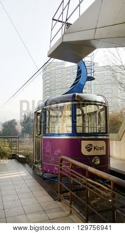 ALMATY, KAZAKHSTAN - January 20, 2016: funicular with tourists