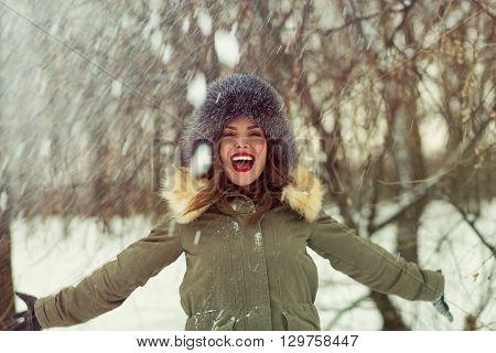 Beautiful Woman In Winter Coat And Fur Hat