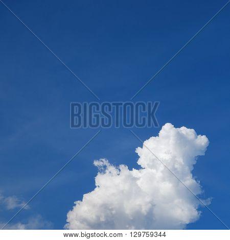 Large Cumulus Cloud On Clear Blue Sky Background
