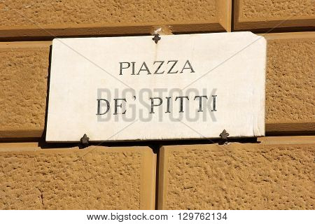 piazza de Pitti, street plate on a wall of old house in Florence, Italy