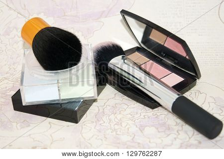 Loose Powder And Blushes On Flower Background