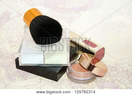 Basic Make-up Products. Powder, Eyeshadow, Lipstick