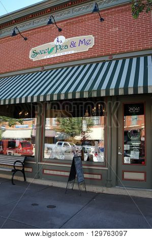 PLAINFIELD, ILLINOIS / UNITED STATES - SEPTEMBER 20, 2015: One may purchase clothing and accessories for women and children at the Sweet Pea and Me boutique in downtown Plainfield.