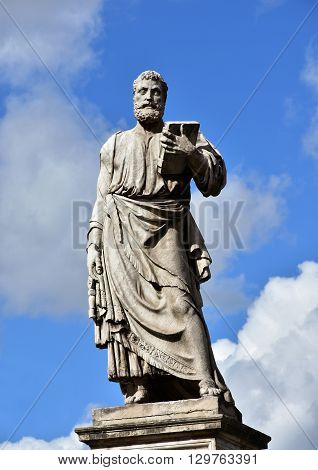 Saint Peter with the key of paradise. Marble statue of St Peter patron of Rome at the entrance of Sant'Angelo monumental bridge created by sculptor Lorenzetto in the 16th century