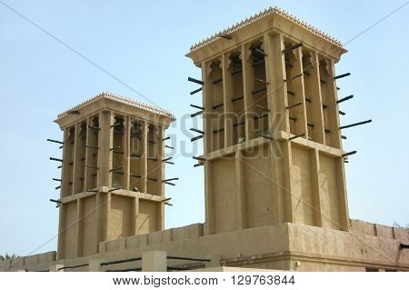 Close up of an ancient wind towers- a traditional arabic technique for cooling hot air during summer.