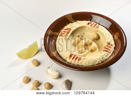 Bowl of  Hummus - a middle eastern cuisine with raw ingredients.