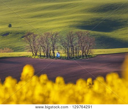 Spring Landscape With Amazing Chapel In Green Fields At Sunset