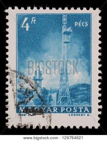 ZAGREB, CROATIA - JUNE 24: A stamp printed in Hungary shows Pecs TV Tower, with the same inscription, from series Transport and Telecommunication, circa 1964, on June 24, 2014, Zagreb, Croatia