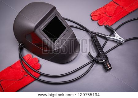 Welding equipment, welding mask, protective leather gloves, high-voltage wires with clips, set of accessories for arc welding.