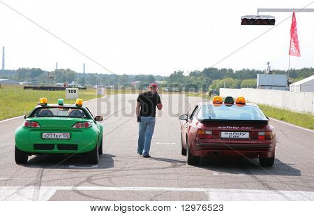 """MOSCOW - JUNE 22: Two cars on line on The second stage of the Championship of Russia June 22, 2008 in autodrome """"Miachkovo"""", Moscow."""