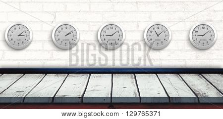 Five white clock against wooden background