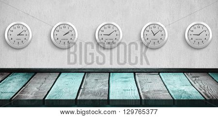 Five white clock against a colorful parquet
