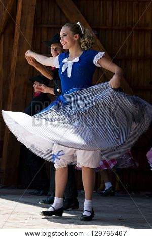 ROMANIA TIMISOARA-JULY 12 2015:Unidentified youths from California in traditional dress presented an specific dance at a international folk dance festivalduring International Festival of hearts