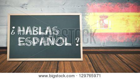 hablas espanol against spain flag in grunge effect