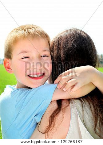 Happy Kid and Mother at the Summer Field