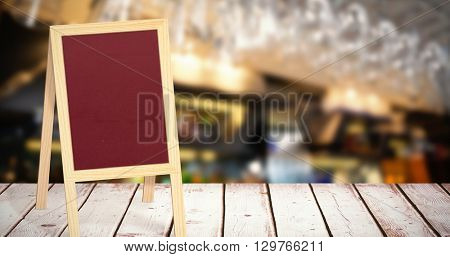 Glasses suspended on a rack against a red board in a white background
