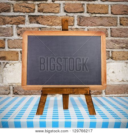 Image of a blackboard against image of a wall
