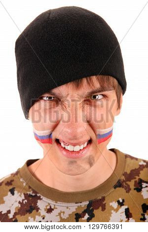 Young Man Portrait with Dirty Face and Russian Flag on the Cheeks