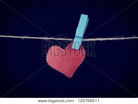 Toned Photo of Heart Shape on the Rope