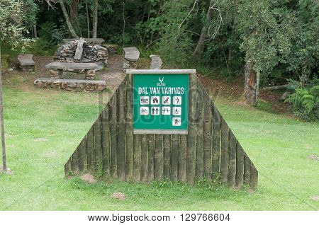 KNYSNA SOUTH AFRICA - MARCH 5 2016: An information board at the The Valley of Ferns picnic spot on the Prince Alfred Pass with barbecue facilities in the back