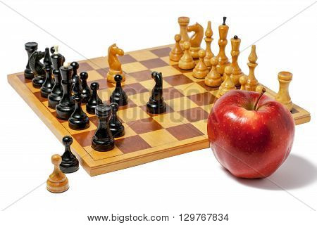 Chess board with figures and a red apple