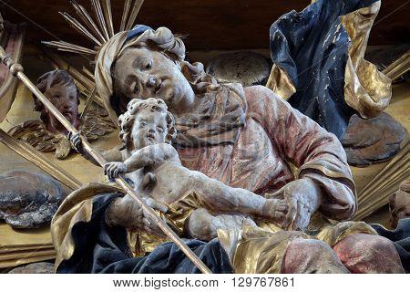 KOTARI, CROATIA - SEPTEMBER 16: Virgin Mary with baby Jesus, main altar in the church of Saint Leonard of Noblac in Kotari, Croatia on September 16, 2015.