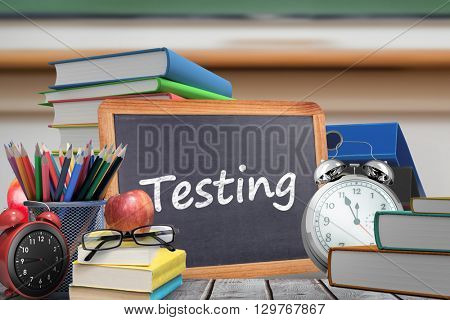 Testing word against red apple on pile of books in classroom