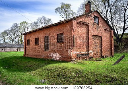 Small Red Brick Warehouse among bastion hills in Daugavpils fortress, Latvia