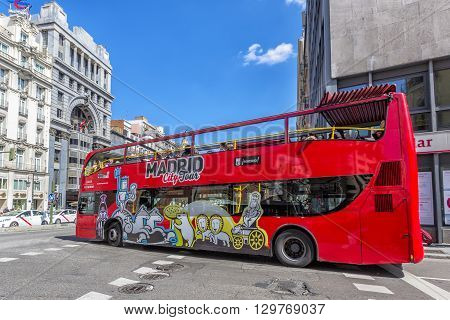 MADRID SPAIN - MARCH 23 2016: Touristic bus in Madrid Spain. Madrid City Tour is a touristic bus service that shows the city with an audio guide.
