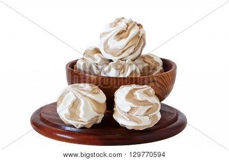 Soft delicious zephyr in a wooden bowl isolated on white background.