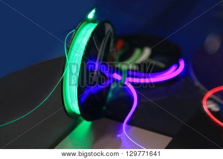 Coil with fiber-optic wire to transmit information with light.