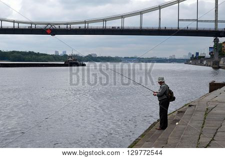 KIEV,UKRAINE - MAY 15, 2016: An unidentified person fishing.Downtown. Historical area of Kiev. Ukraine