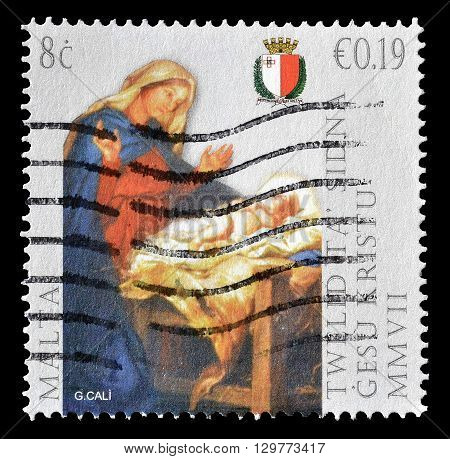 MALTA - CIRCA 2007 : Cancelled postage stamp printed by Malta, that shows Madonna and Baby Jesus by Giuseppe Calì.