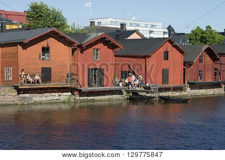 PORVOO, FINLAND - JUNE 13, 2015: Summer evening on the historic waterfront town of Porvoo. Historical landmark of the city Porvoo, Finland