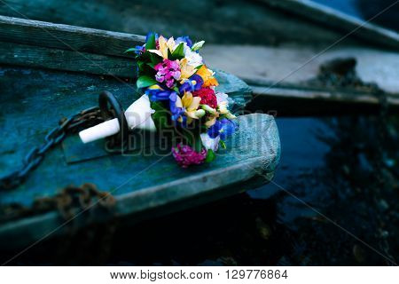 Bridal bouquet. Wedding bouquet. Bouquet of flowers and boat chain. Flowers in boat. Bouquet of flowers