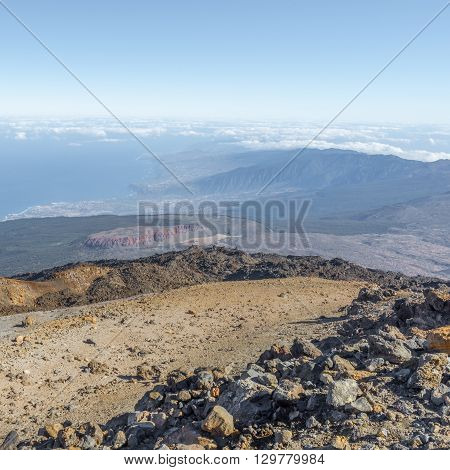 From the slope of the volcano Teide can be seen how clouds hung over the coast of Tenerife. Spain.
