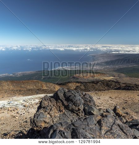 The slopes of the volcano Teide on Tenerife island towering above a rare cloud at its foot. Spain.