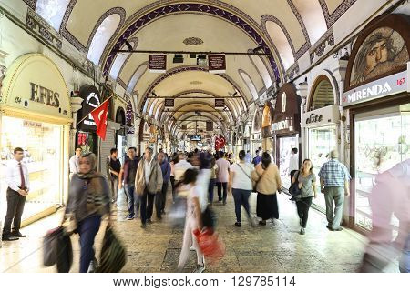 ISTANBUL TURKEY - MAY 14 2016: People shopping in the Grand Bazaar. The Grand Bazaar is one of the largest and oldest covered markets in the world.